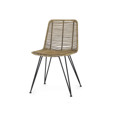 The Cochabamba Side Chair has a black metal frame hand-wrapped with natural rattan rope.