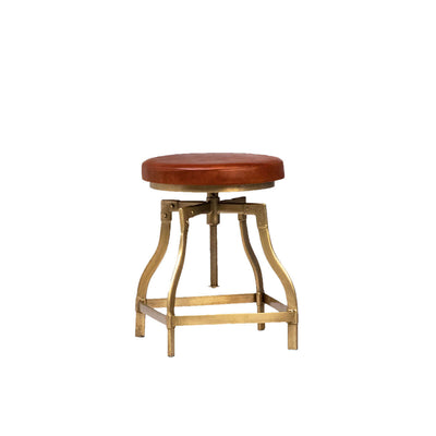 The Sanfran Stool is an adjustable counter stool with a brown leather seat and antique brass frame with a footrest.