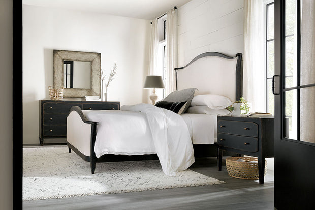 Black modern farmhouse nightstand in a traditional bedroom.