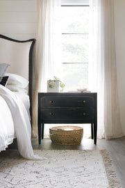 Antique nightstand in a traditional bedroom.