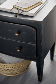 Closeup of the antique farmhouse inspired black nightstand with two drawers and hand-distressed finish.