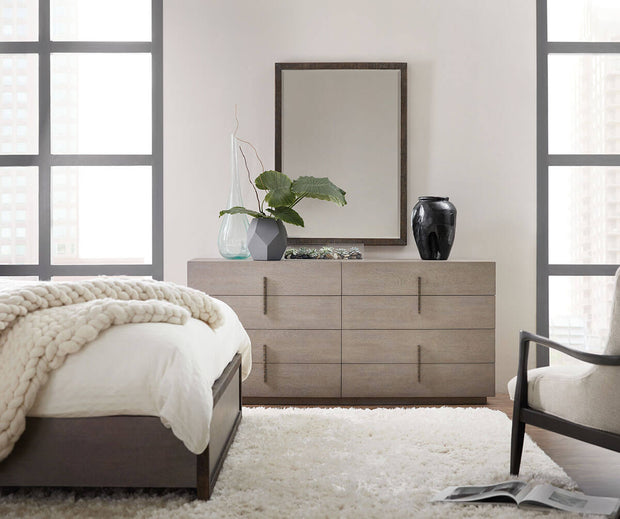Grey wood nightstand in a neutral bedroom.