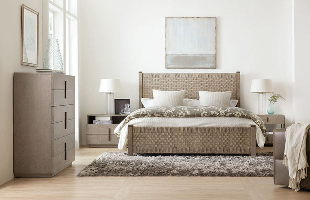 Neutral, six drawer chest in a coastal bedroom.