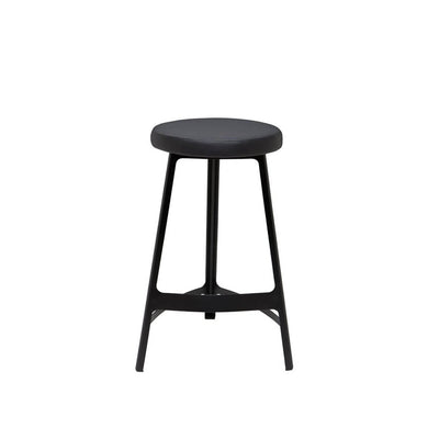 The Naha Bar Stool has a steel frame, slightly curved lines, and a faux leather seat.