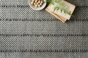 Durable hand woven rug with dark charcoal stripes. Textured charcoal hand woven rug.