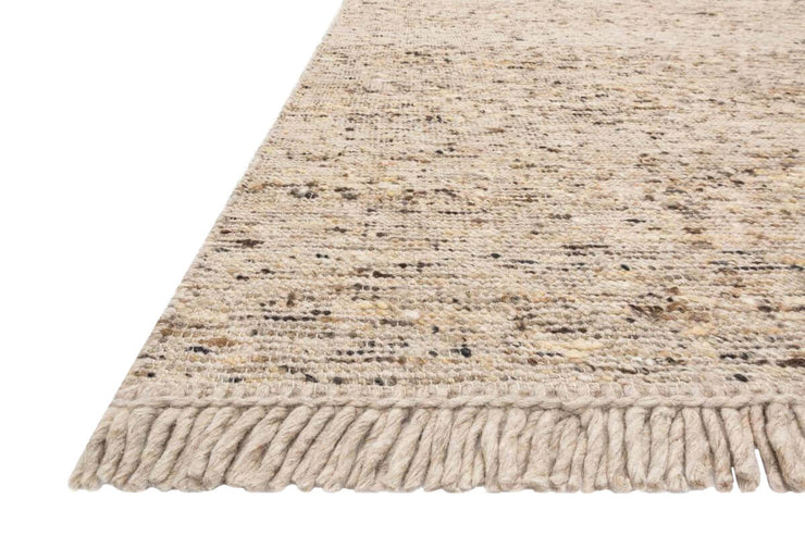 Heathered brown rug. Fringe and texture details on the Nevada Fawn Rug.
