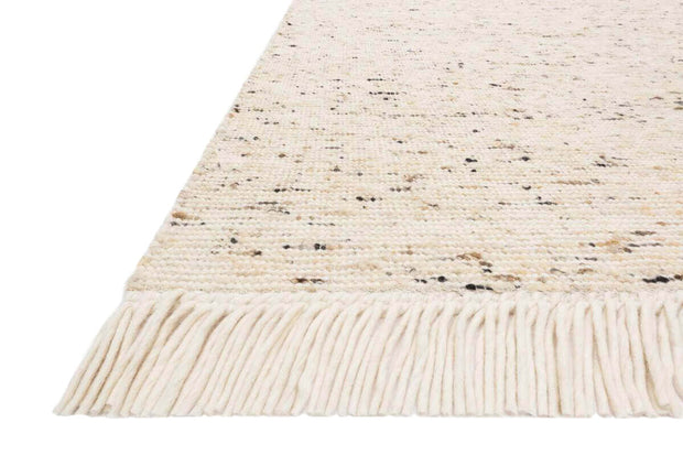 Ivory heathered rug with fringe detail. Nevada Ivory  Rug fringe and texture details.