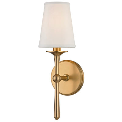 This traditional, aged brass sconce has antique features such as its bobeche candle sleeves, faux silk shade, and cast metal.