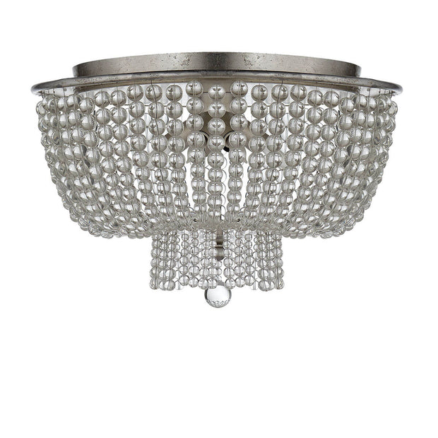 The Jacqueline Flush Mount has a silver leaf canopy and a pendant with strings of clear glass beads.
