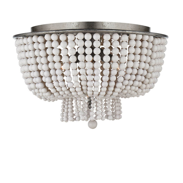 The Jacqueline Flush Mount has a silver leaf canopy and a pendant with strings of white acrylic beads.