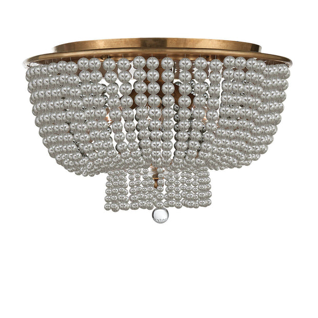 The Jacqueline Flush Mount has a hand-rubbed, antique brass canopy and a pendant with strings of clear glass beads.