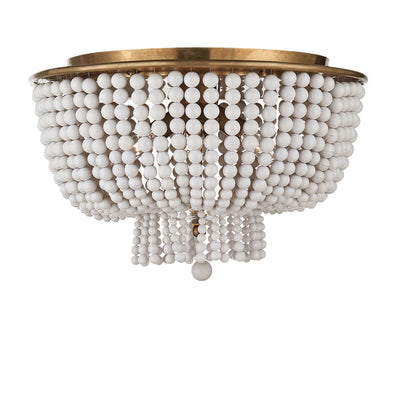 The Jacqueline Flush Mount has a hand-rubbed, antique brass canopy and a pendant with strings of white acrylic beads.