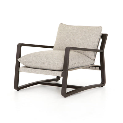 Grey outdoor lounge chair with bronze base.