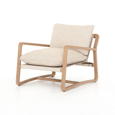 Outdoor beige lounge chair with teak frame.