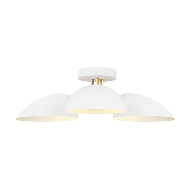 London Flush Mount with a burnished brass body and matte white glass shades.