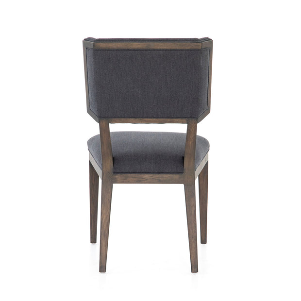 Dark wood framed dining chair with blue fabric on front and back.