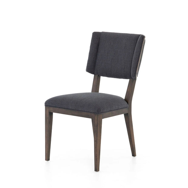 Dark wood dining chair with blue fabric seat and back.