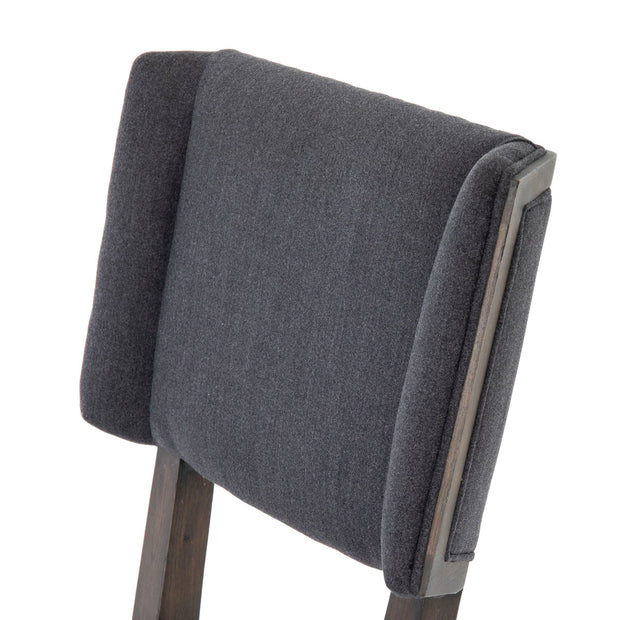 Detail on blue grey dining chair. Comfortable winged seat back.
