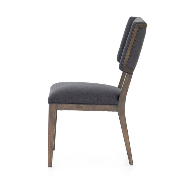 Blue grey dining chair with a dark wooden frame.