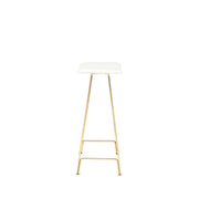 Small, modern counter stool with slim gold legs and white leather seat.