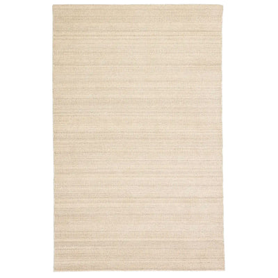 Soft, tribal patterned rug made of wool and viscose in a neutral beige.