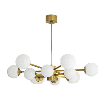 The Portland Chandelier with antique brass and opal glass spheres in an irregular symmetrical design.