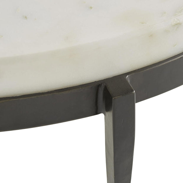 Hand-forged, dark iron legs with tapered bottom and a white marble tabletop.