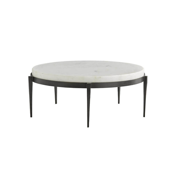 The Tartu Cocktail Table has hand-forged, black iron legs and a chunky white marble top.
