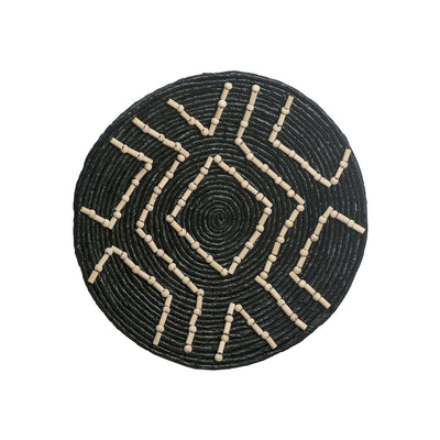 The Accra Wall Basket is a black woven basket with an abstract tribal pattern made from wooden beads.