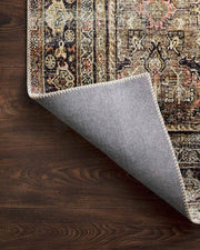Canvas backing on the Garda Olive / Charcoal Rug. Canvas backing on a patterned rug.