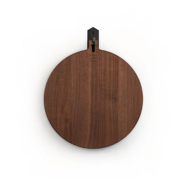 The Leister Wood Board - Walnut is a medium-sized, round board made of walnut wood for charcuterie or cutting.