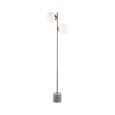 The Oxnard Floor Lamp is a minimalist floor lamp with a marble base, steel post and floating opal glass balls.