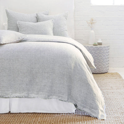 The Oaxaca Bedding Collection - Navy is a 100% linen duvet cover with heathered detail and frayed edges.