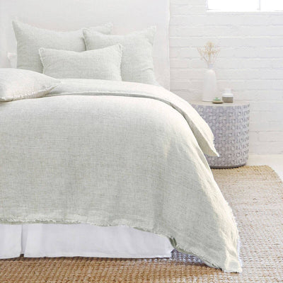The Oaxaca Bedding Collection -Olive is a 100% linen duvet cover with heathered detail and frayed edges.