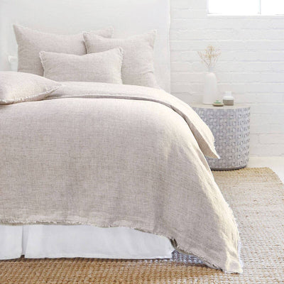 The Oaxaca Bedding Collection -Terra Cotta is a 100% linen duvet cover with heathered detail and frayed edges.