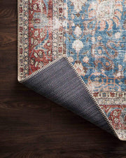 Cotton canvas backing on the Lille Blue / Brick Rug. Rug with cotton canvas backing.