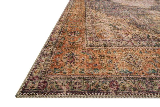 Colour and pattern of the Lille Plum / Multi Rug. Plum and rust coloured Turkish rug.