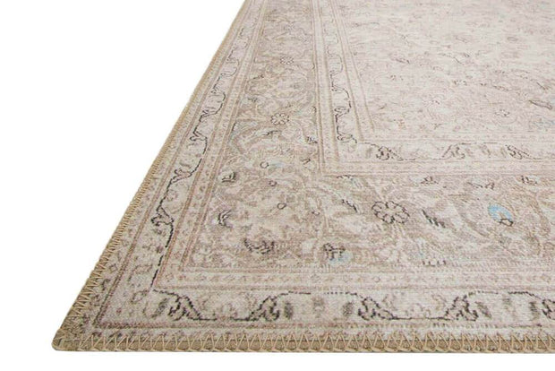 Sand and taupe affordable rug that has a vintage, turkish rug look.