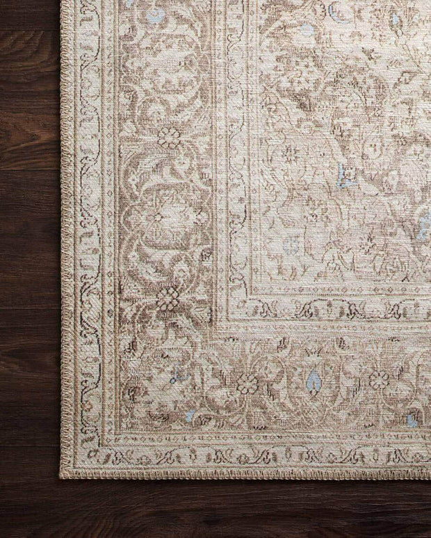Classic and traditional inspired pattern on a neutral light brown rug.