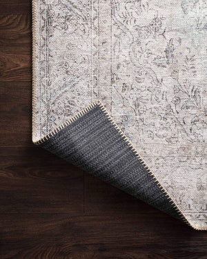 Cotton canvas backing on the Lille Silver / Slate Rug. Cotton canvas backing on a light neutral rug.
