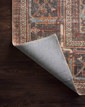 Canvas cotton backing on a dark red and blue patterned rug.