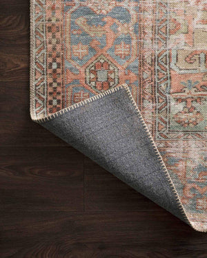 Cotton canvas backing on the Lille Terracotta and Sky Rug. Cotton canvas backing on a red and blue rug.