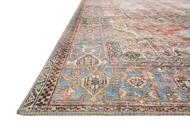 Terracotta and sky rug with a distressed vintage inspired look. Affordable turkish rug.