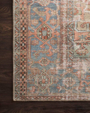 Terracotta and blue rug with a vintage inspired pattern and distressed rug.