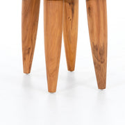 Tapered legs on aged teak stool.