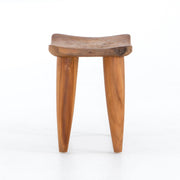 Side view of aged teak stool.