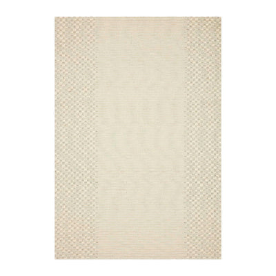 Top view of a textural, bohemian, hand-woven rug in a creamy ivory colour.