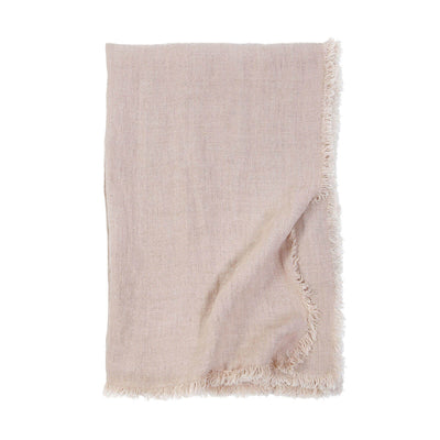 The Genoa Oversized Throw is an oversized light pink throw with 100% linen with frayed edges.