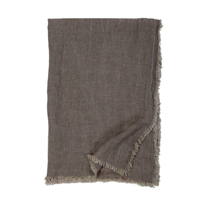 The Genoa Oversized Throw is an oversized dark brown throw with 100% linen with frayed edges.