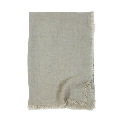 The Genoa Oversized Throw is an oversized light green throw with 100% linen with frayed edges.